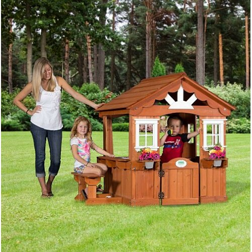 outdoor wooden playhouse promotes imaginative play